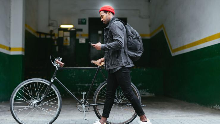 man with bike looking at phone