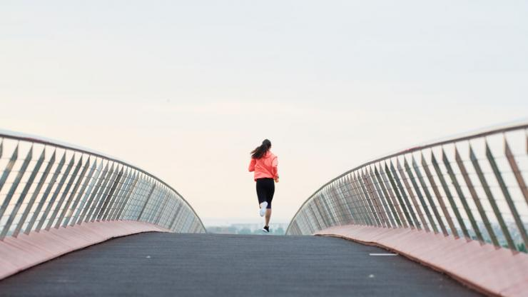 woman running on the bridge