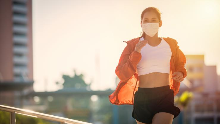 Woman running outside with mask on