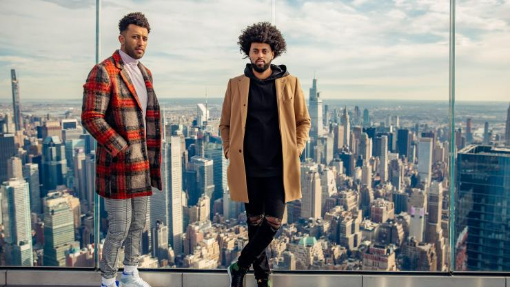 Founders of Foy: Moose and Yon Haile standing on the top of a NYC skyscraper