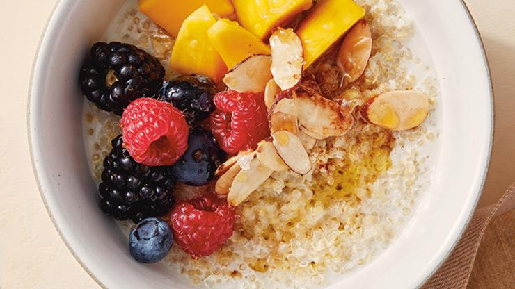"Quinoa oatmeal with berries, mango and almond slivers; from ""Eat Better, Feel Better"" by Giada DeLaurentiis"