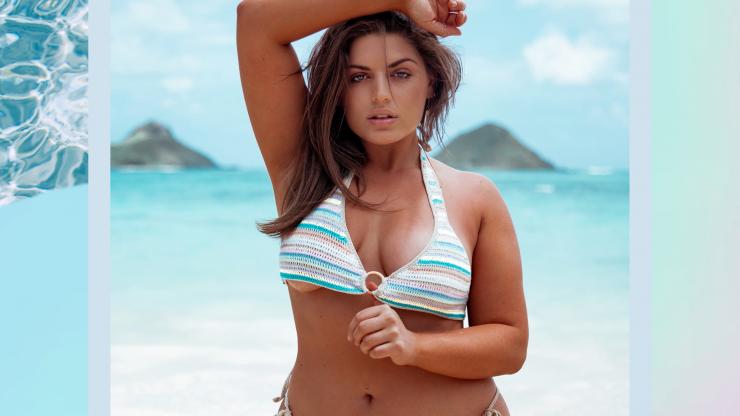 Ella Halikas poses in a bathing suit on the beach.