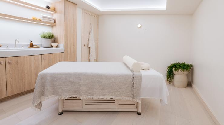 Massage table in one of THE WELL's treatment rooms.