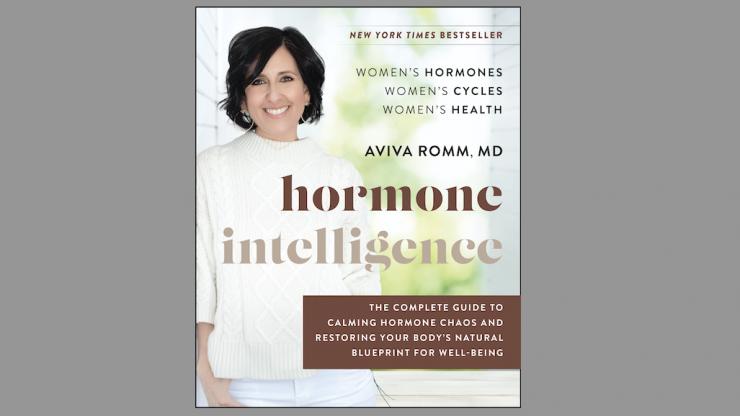 """Aviva Romm smiling on the cover of """"Hormone Intelligence."""""""